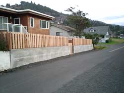 cedar fencing with concrete retaining wall